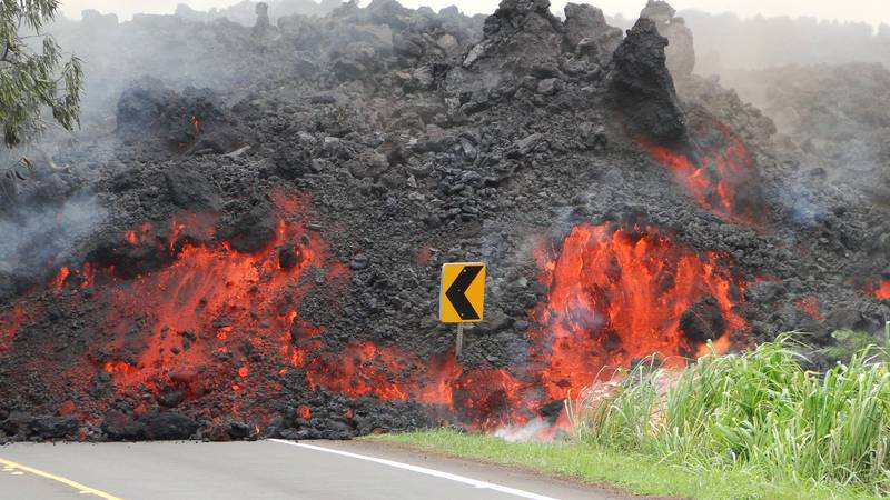 Lava crosses a roadway in lower Puna during the 2018 eruption. (Photo: USGS/HVO)