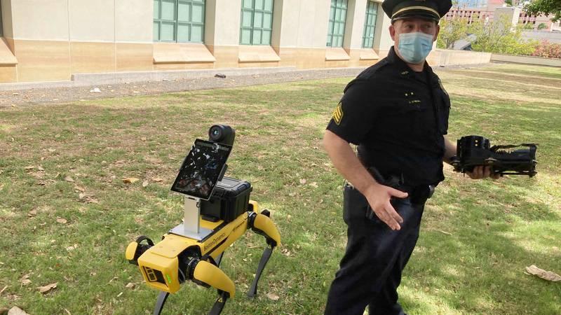 Honolulu Police Acting Lt. Joseph O'Neal demonstrates a robotic dog in Honolulu, Friday May 14,...