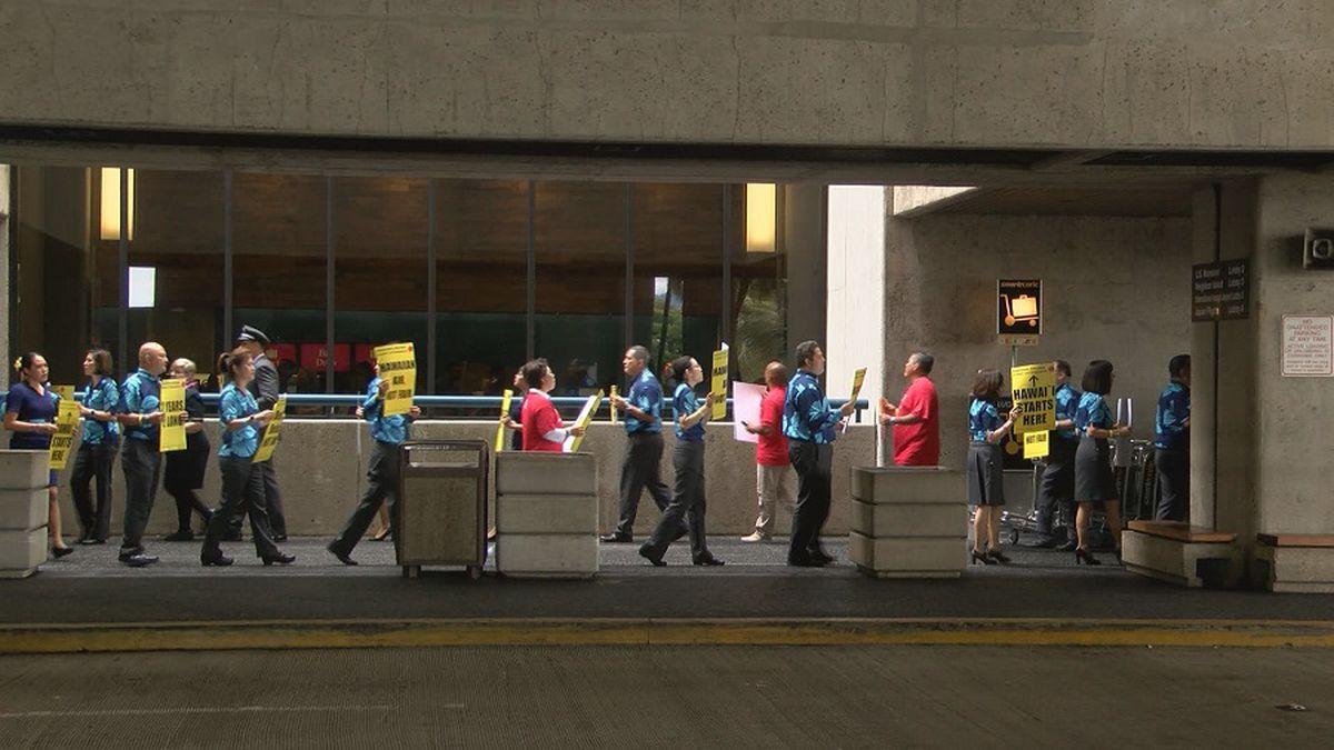 File photo of Hawaiian Airlines flight attendants picketing at the Daniel K. Inouye...