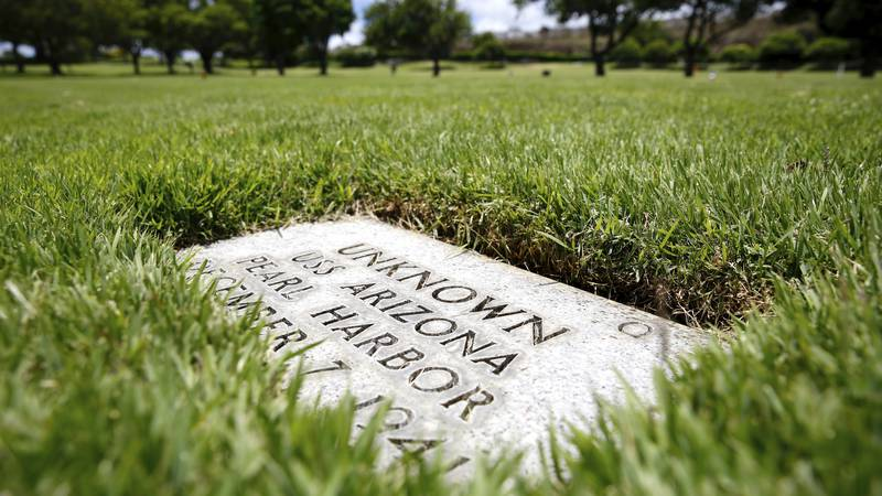 A grave marker for an unknown casualty from the USS Arizona is shown at the National Memorial...