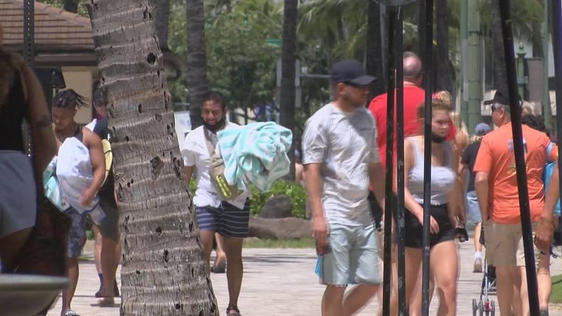 Visitors flock to Waikiki Beach during spring break.
