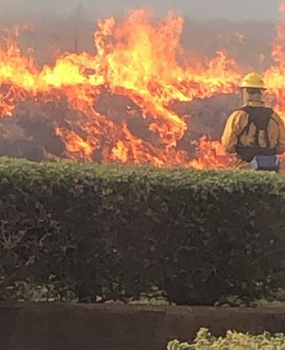 Firefighters are working to douse a large wildfire in West Maui.