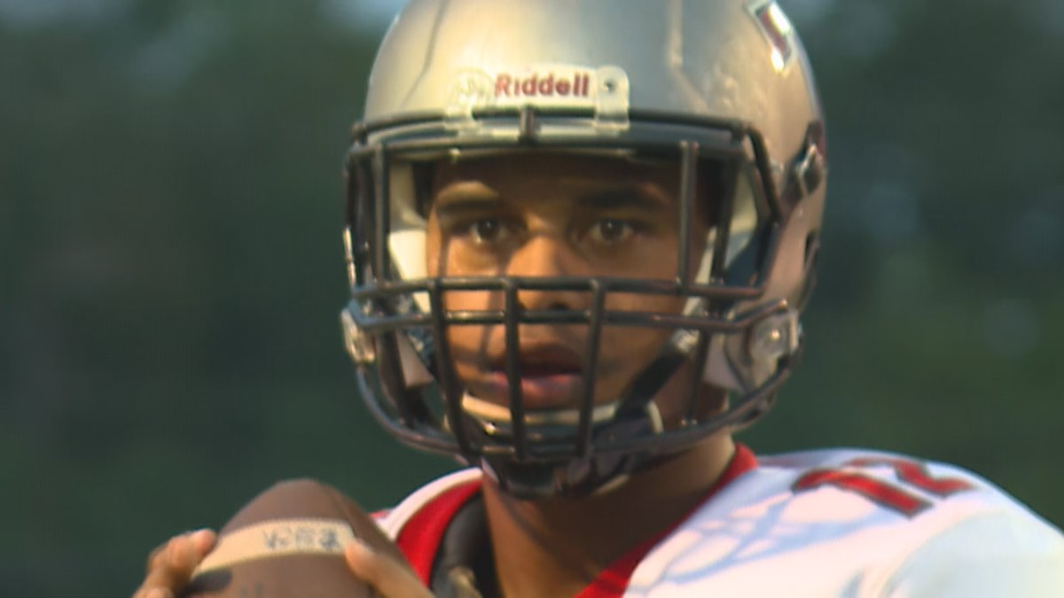 Taulia Tagovailoa, Tua's younger brother, suits up for a game as a high school senior in Alabama.