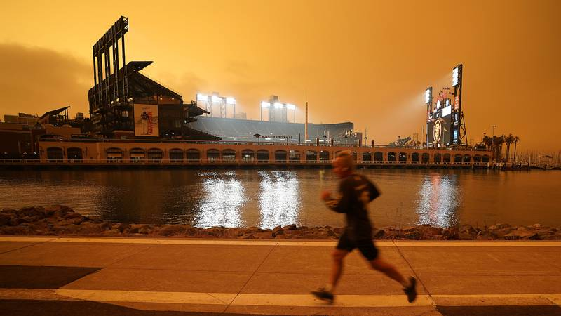 In this Wednesday, Sept. 9, 2020 file photo, a jogger runs along McCovey Cove outside Oracle...