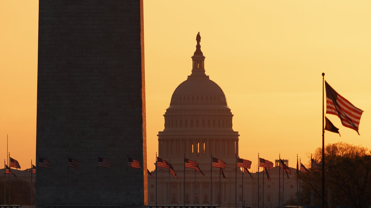 The Washington Monument and the U.S. Capitol are seen in Washington, at sunrise Wednesday,...