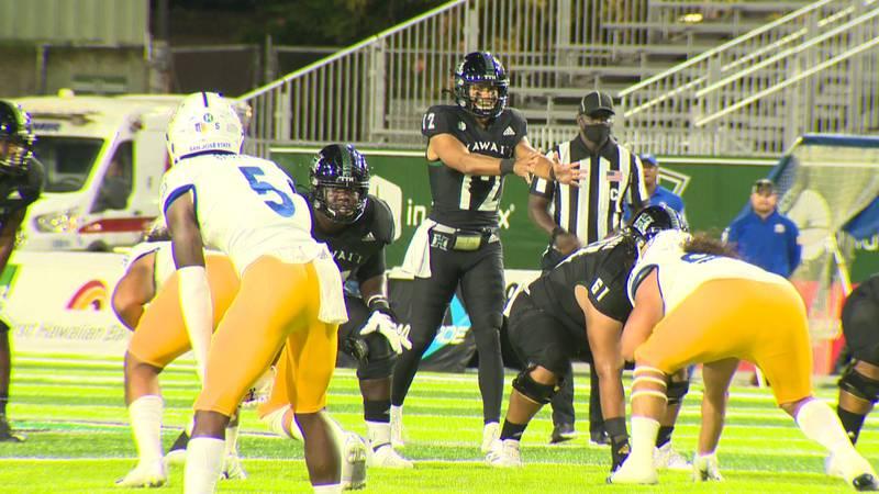 UH junior quarterback Chevan Cordeiro approaches the line