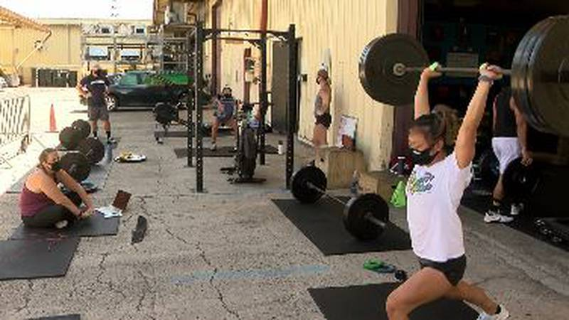 At CrossFit 808 in Kalihi, equipment like rowing machines, exercise bikes, and barbells have...