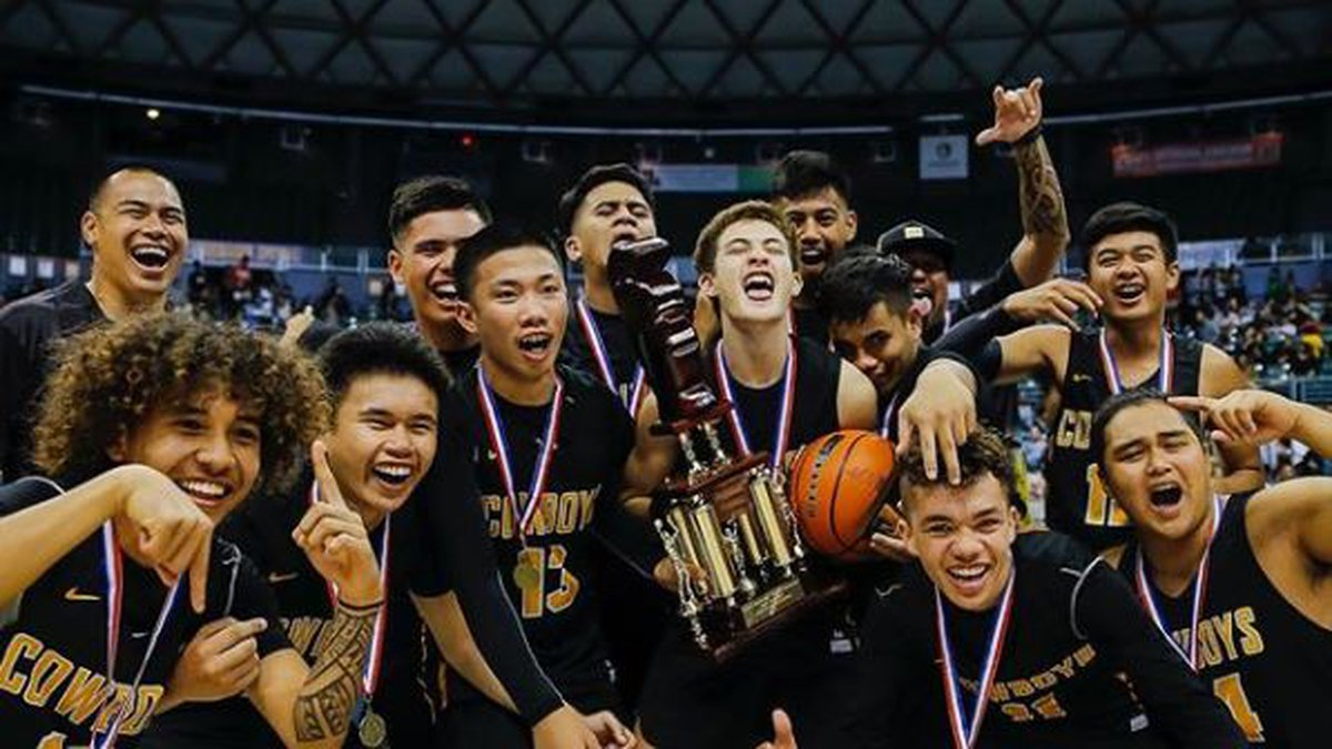 Kohala Cowboys celebrate after defeating Roosevelt 51-48 in Friday night's Division II state...