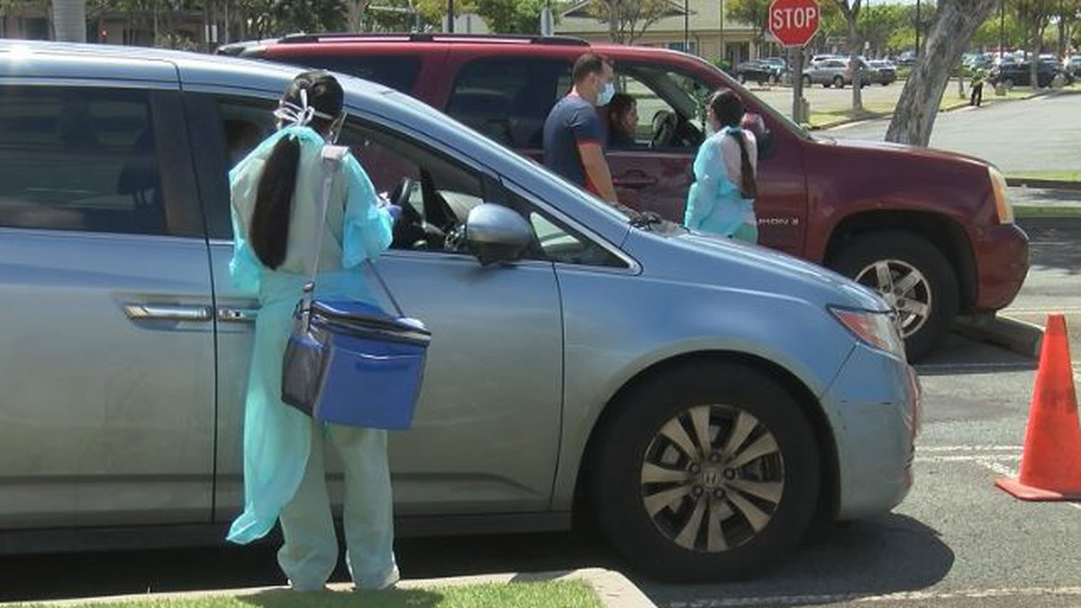 Drive-thru testing centers are now scattered around the islands as the number of coronavirus...