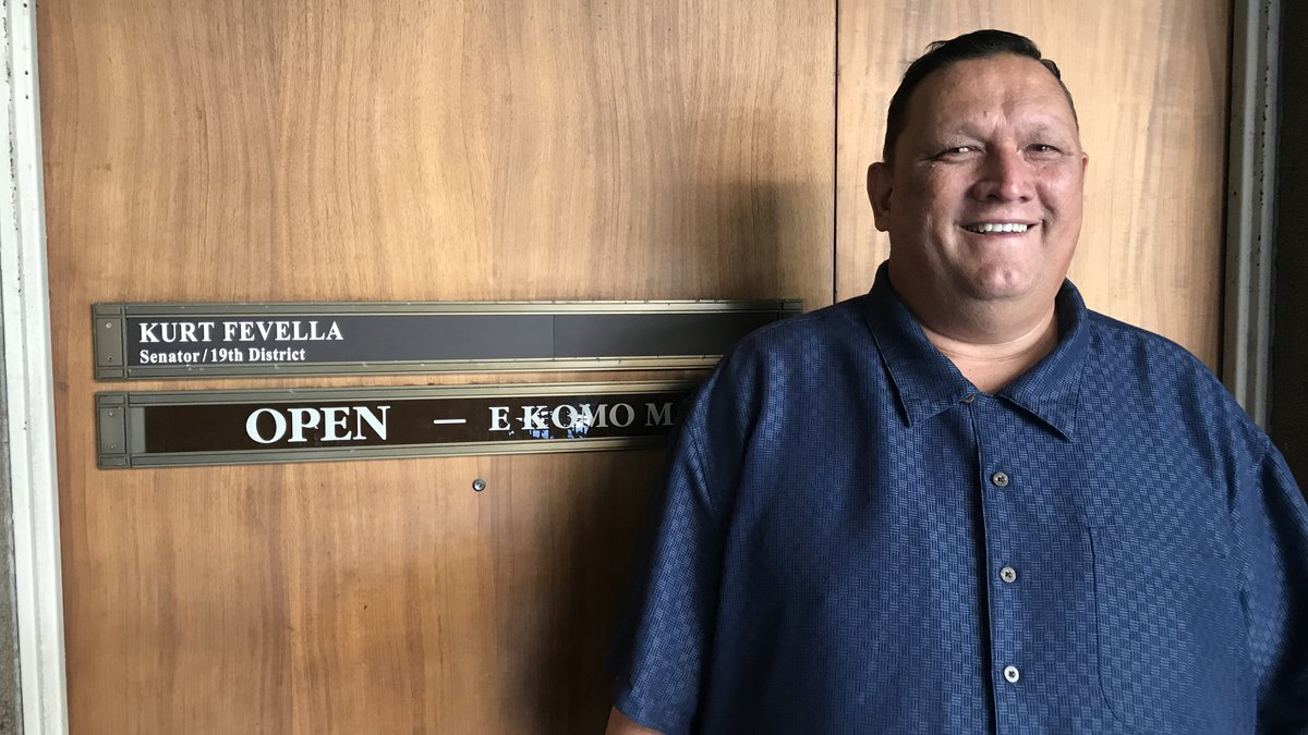 Kurt Fevella stands in front of his new state senate office.