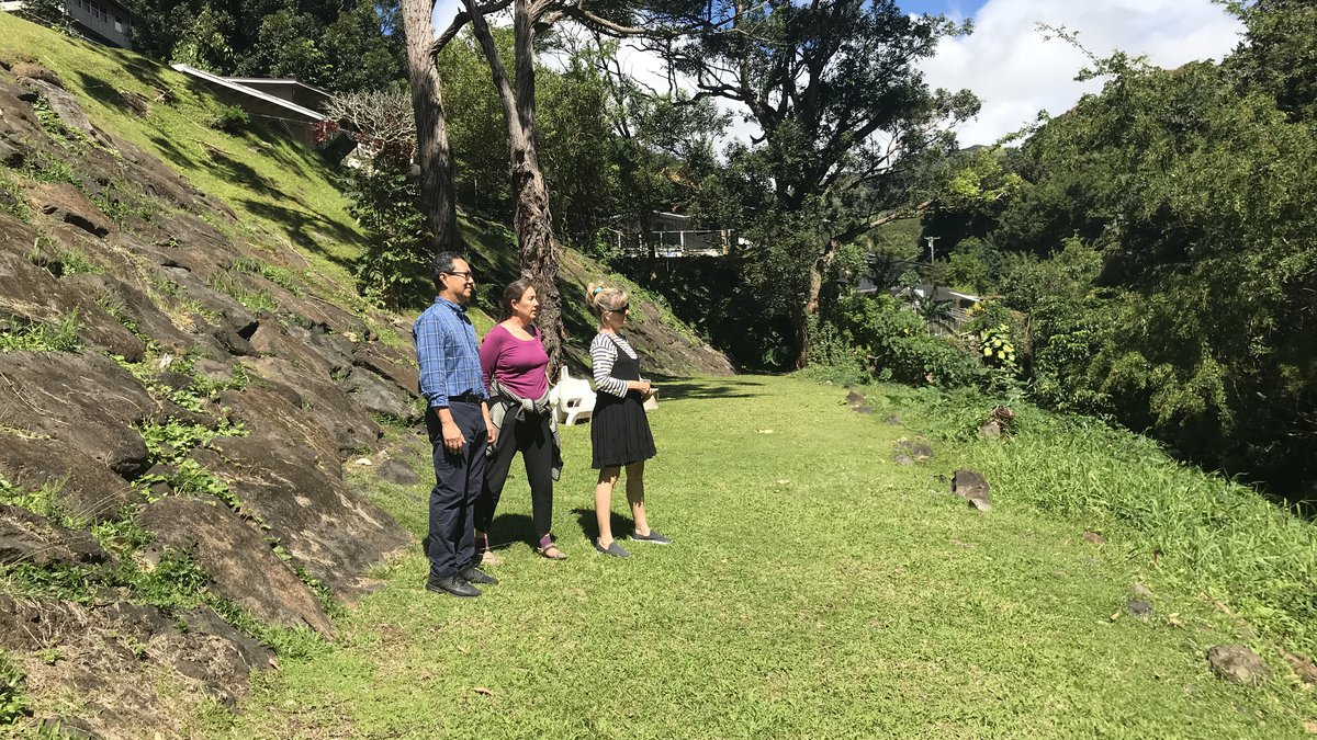 Palolo residents check out Pukele Stream, the site of a potential retention basin.