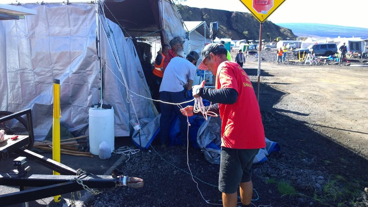 Protesters at the Mauna Kea Access Road removed barricades for the first time since July as the...