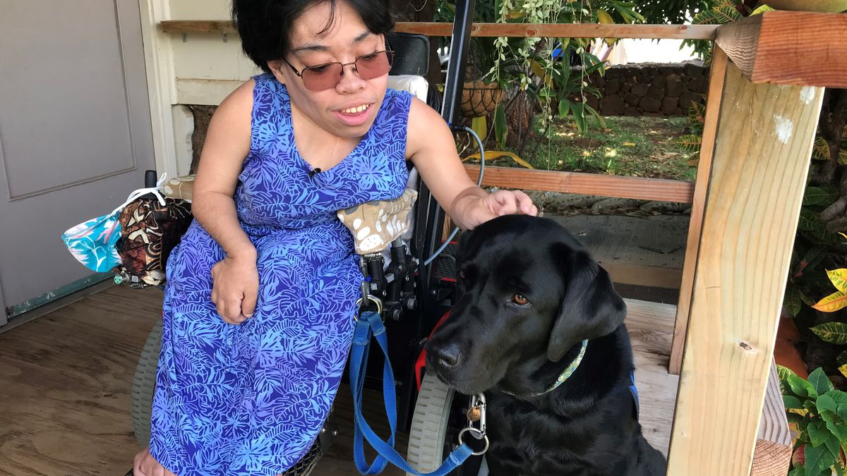 Maria McClellan depends on her dog, Shadow, and a custom-built motorized wheelchair.