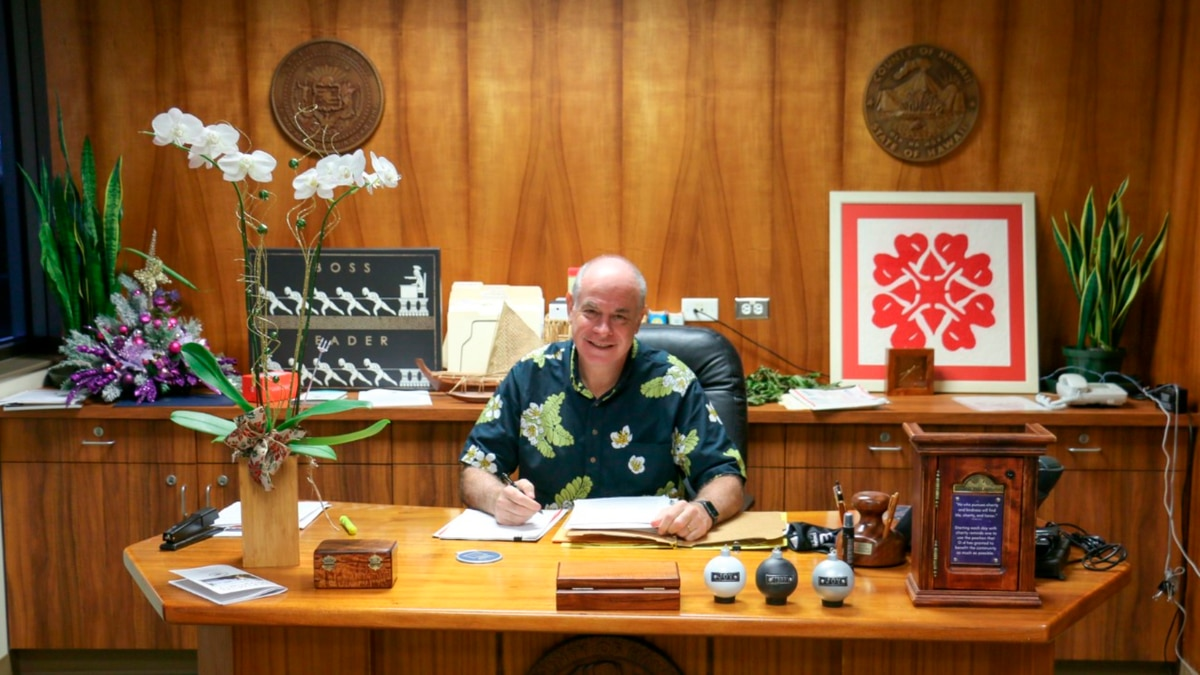 Hawaii County Mayor Mitch Roth smiles as he slowly returns to working in office following a...
