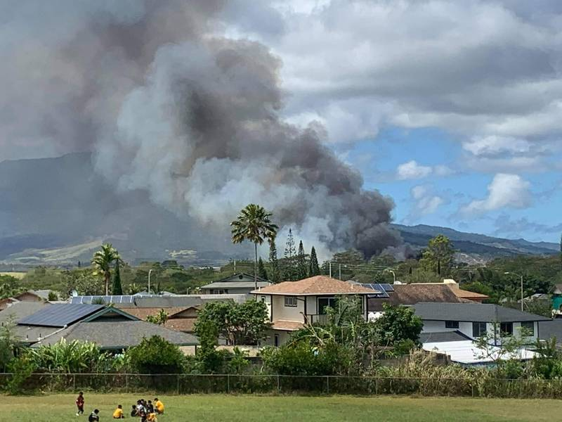 Smoke billowed from the area of the fire in Central Oahu.