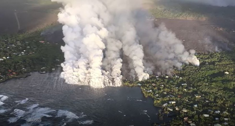 Huge plumes of laze soar into the air above Kapoho as lava hits the sea. (Image: Mick...