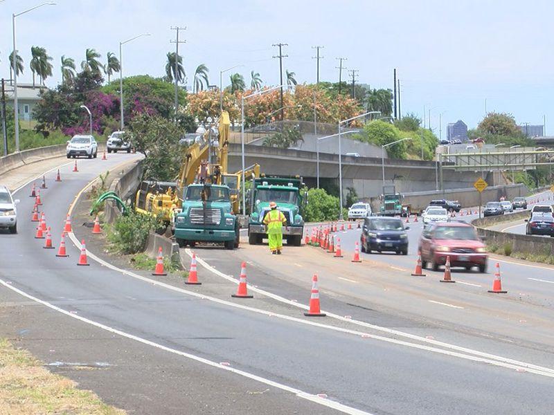 Repair work continues on water main break on Moanalua Freeway.