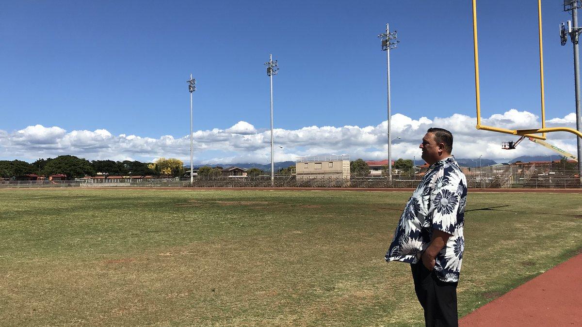 Senator Kurt Fevella looks at the grass athletic field at Campbell High School.