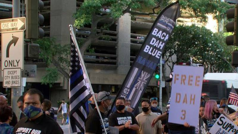 Scores gathered outside a Honolulu courtroom on Friday to support three officers charged in the...