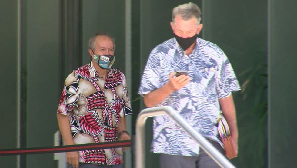 Fmr. Honolulu Police Commissioner Max Sword leaves the fed courthouse with his attorney,...