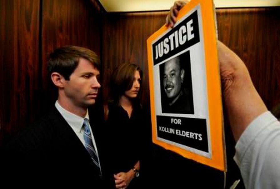 A protestor holds a picture of Kollin Elderts in Deedy's face. Source: Honolulu Star-Advertiser