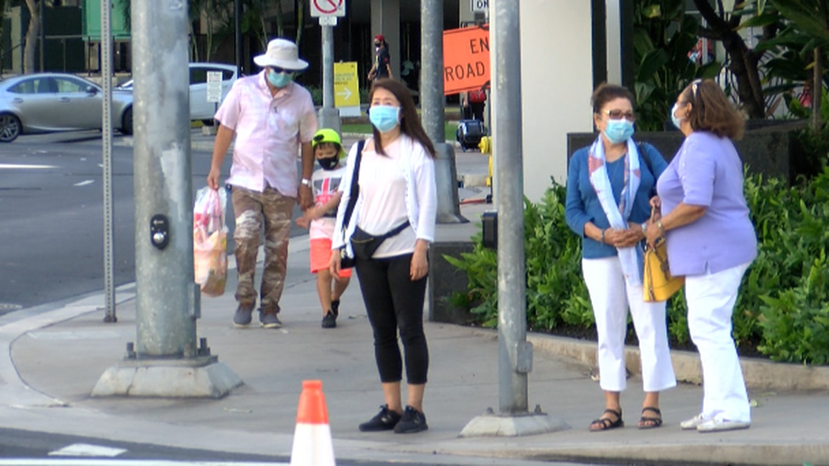 Green suggest people wear mask when social distancing is not possible.