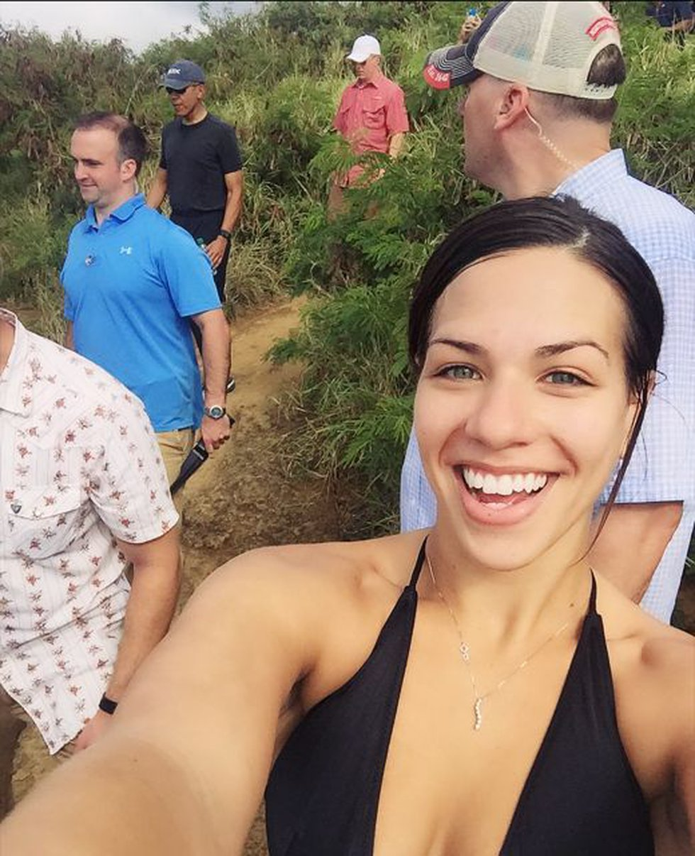 Kehau Kimokeo, 25, a singer and dancer, snaps a selfie with the president in the background....