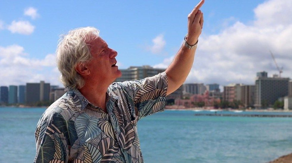 Aquarium director, Andrew Rossiter, points to where he sees waves crash higher than his office...