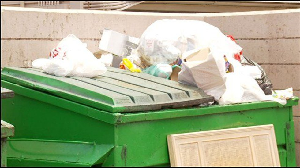 Trash overflows in bins at Mayor Wright Homes