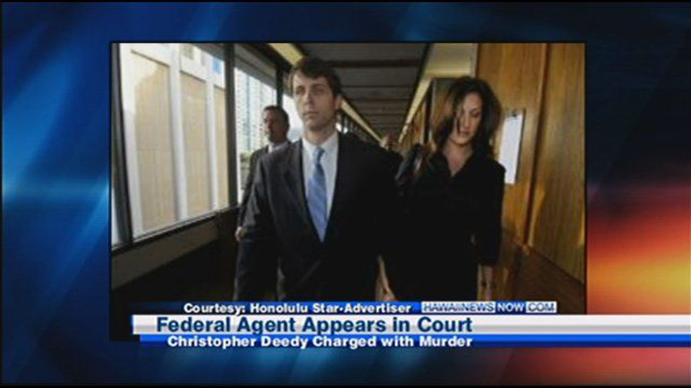 Christopher Deedy walks with his wife.