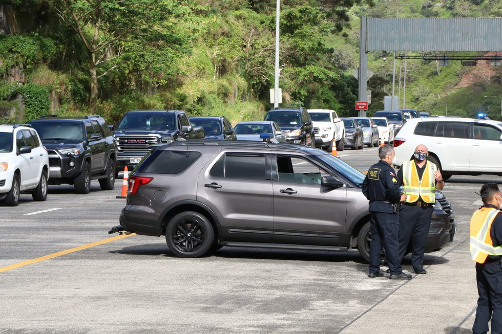 Cars lined both directions of the H-3 Freeway for free COVID-19 surge testing on Tuesday.