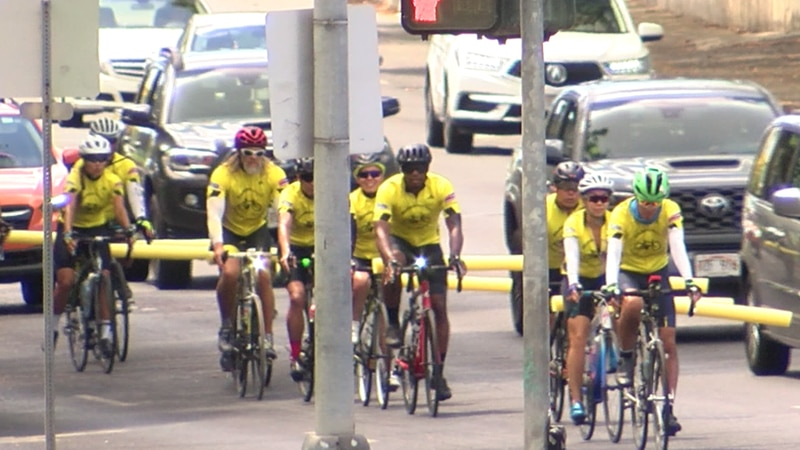 """The """"#Safe Us"""" Bike Team rode with noodles to visually show how far cars should be from them."""
