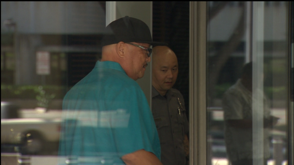 Former ILWU official Nate Lum leaves the federal court house today after he was sentenced to 30...