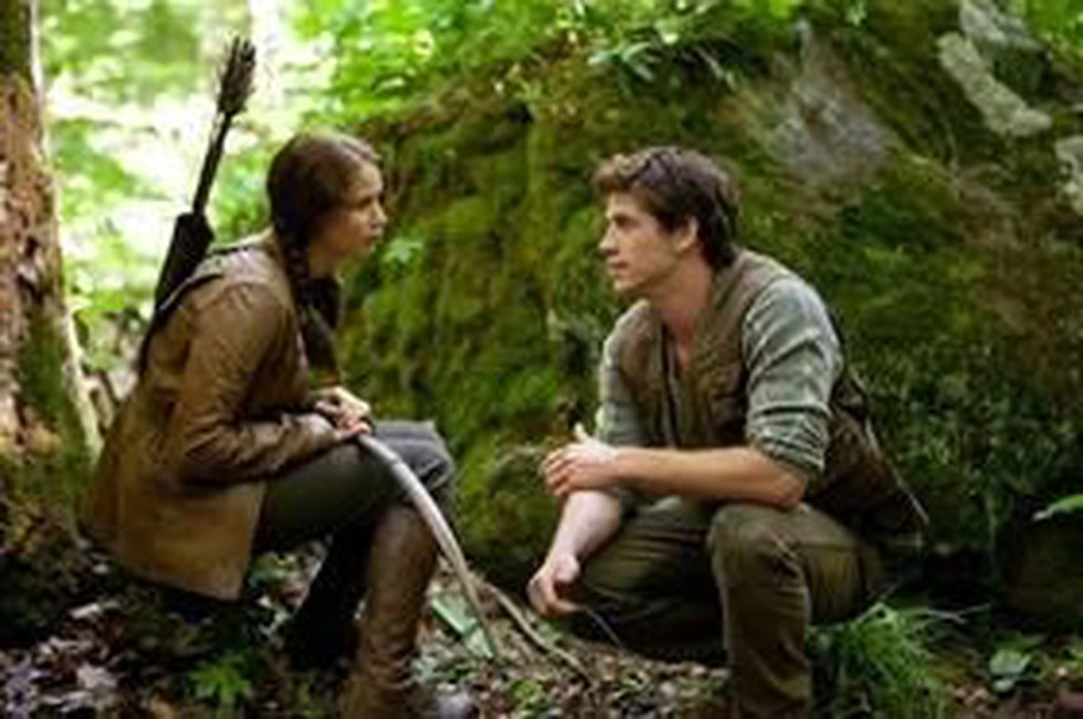 Jennifer Lawrence and Liam Hemsworth as Katniss Everdeen and Gale Hawthorne in 'The Hunger...
