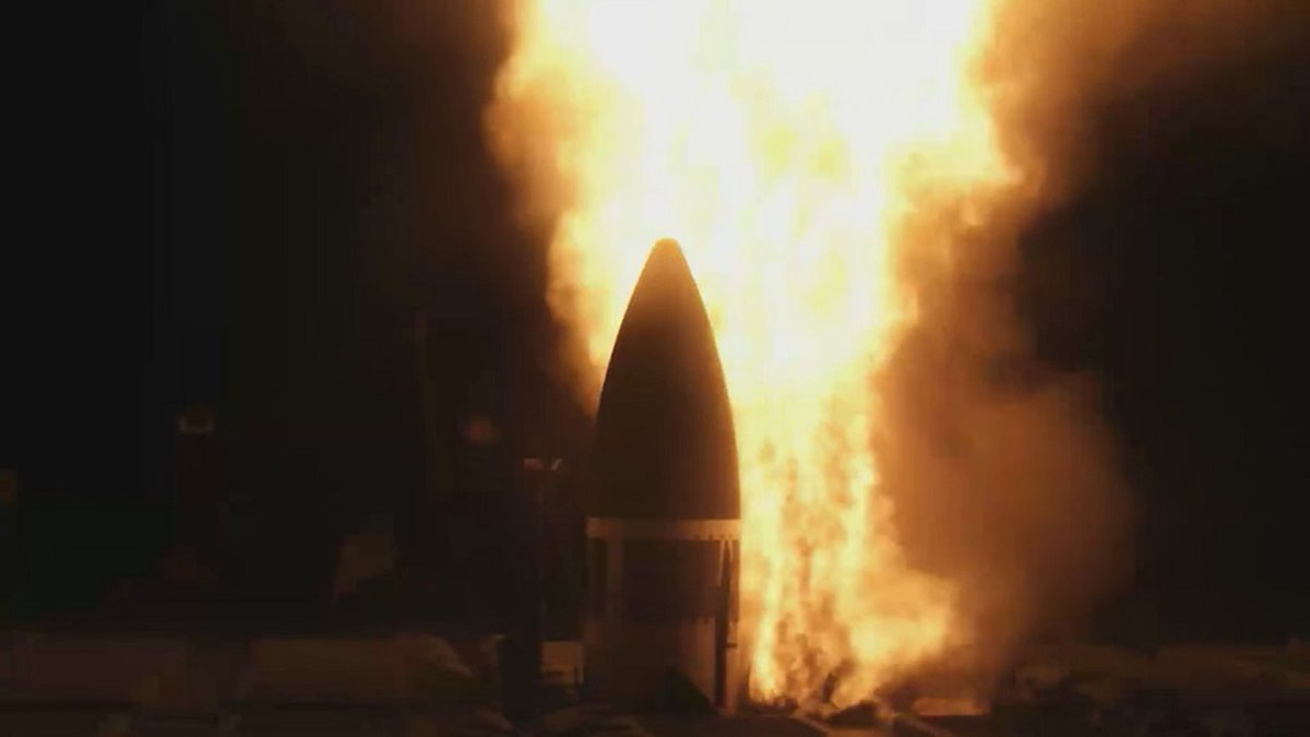 A missile interceptor launched from a U.S. Navy ship at sea hit and destroyed a mock ICBM in...