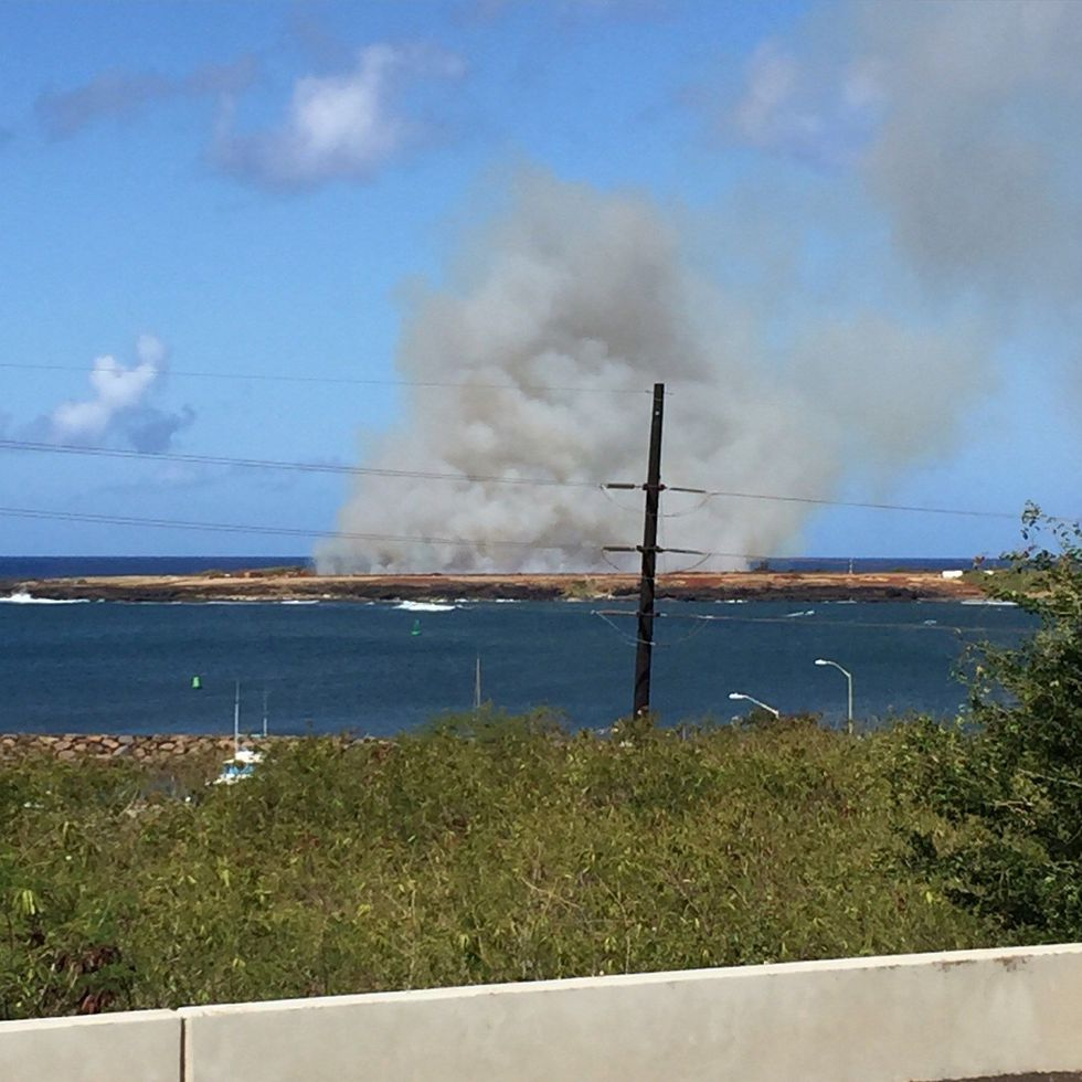 Smoke is seen billowing from the crash site (Image: Viewer)