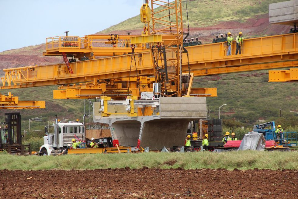 Crews working on the Honolulu rail project prepare to life a portion of the elevated guideway...