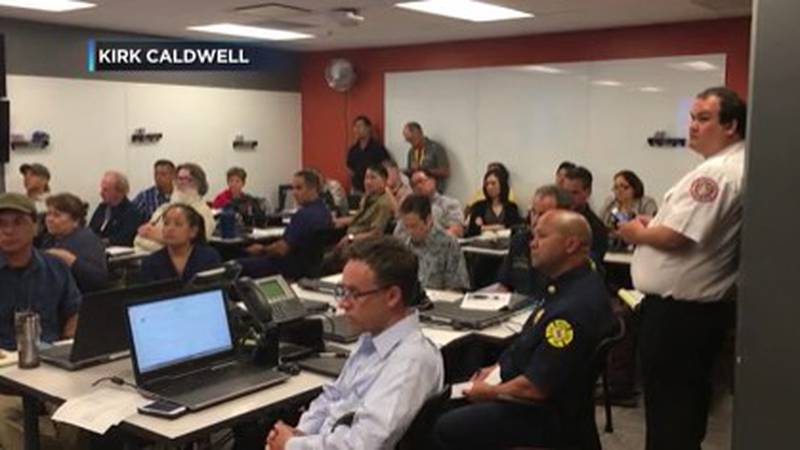 Key personnel from various agencies meet in the Emergency Operations Center during a disaster.