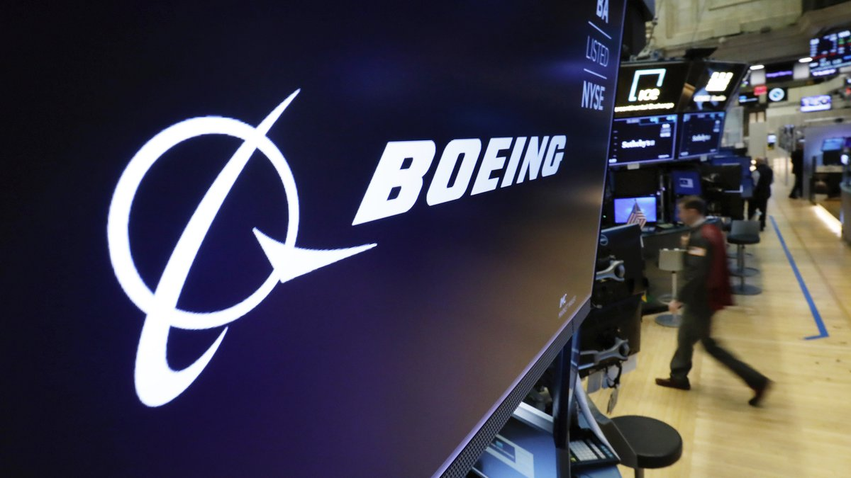 The Boeing logo appears above a trading post on the floor of the New York Stock Exchange before...