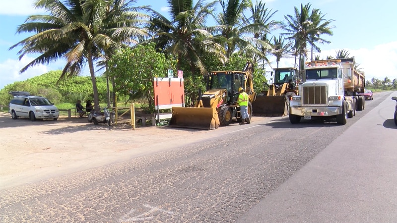 Heavy equipment is being used to remove derelict vehicles and trash from the encampment along...