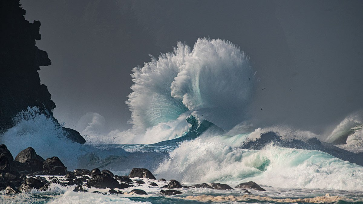 A wave breaks along the shoreline at Kee Beach on Kauai. A huge northwest swell is forecast to...
