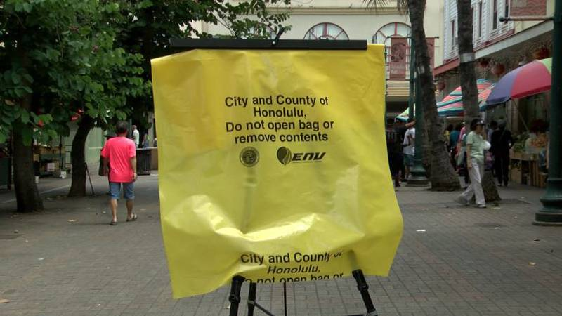 These yellow bags are the city's solution to Chinatown's trash problem.