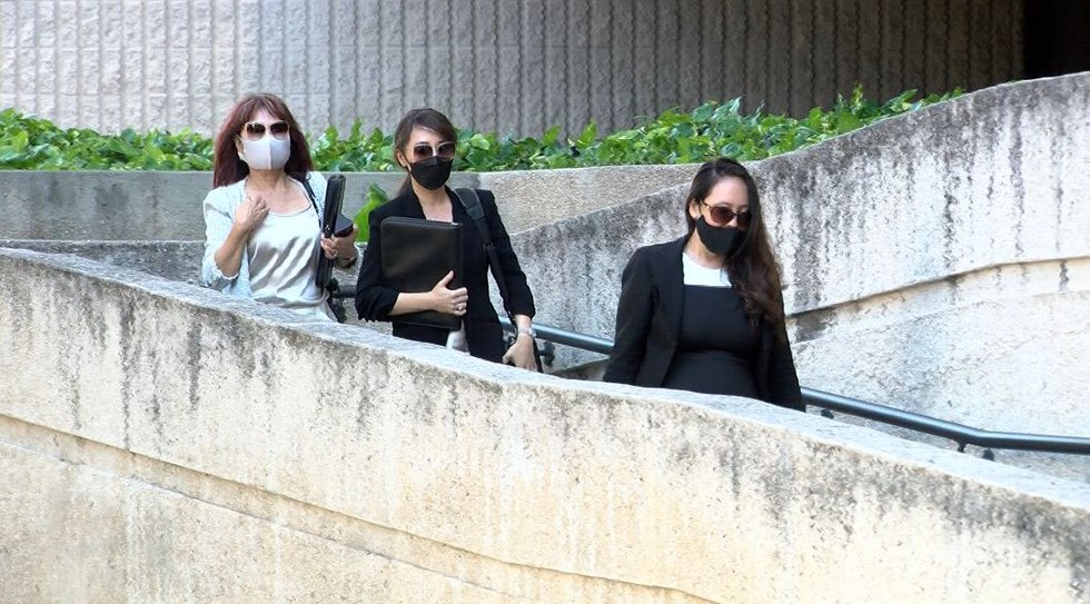 Attorney Sheri Tanaka with clients Lois Mitsunaga and Chan Mitsunaga as they leave the federal...