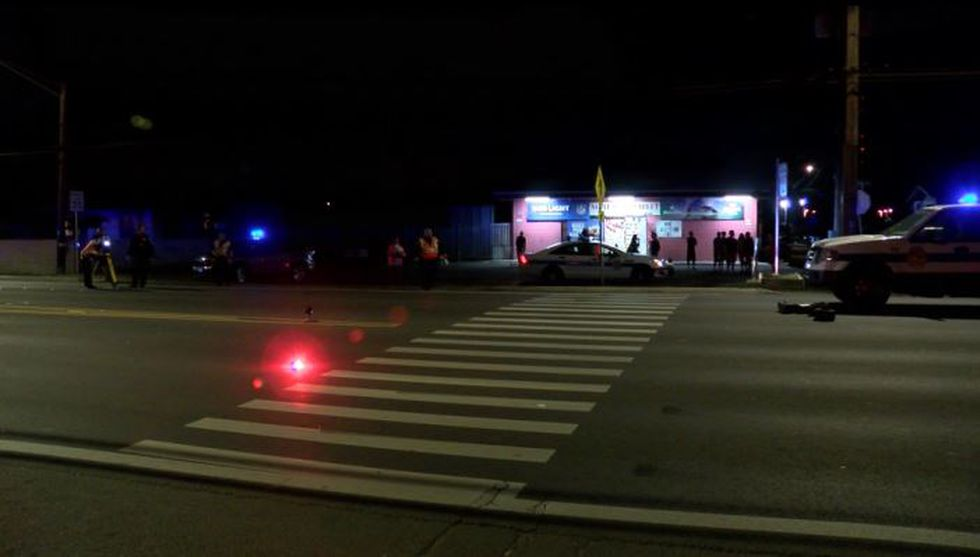 Police closely examined the scene of the crash Friday night.