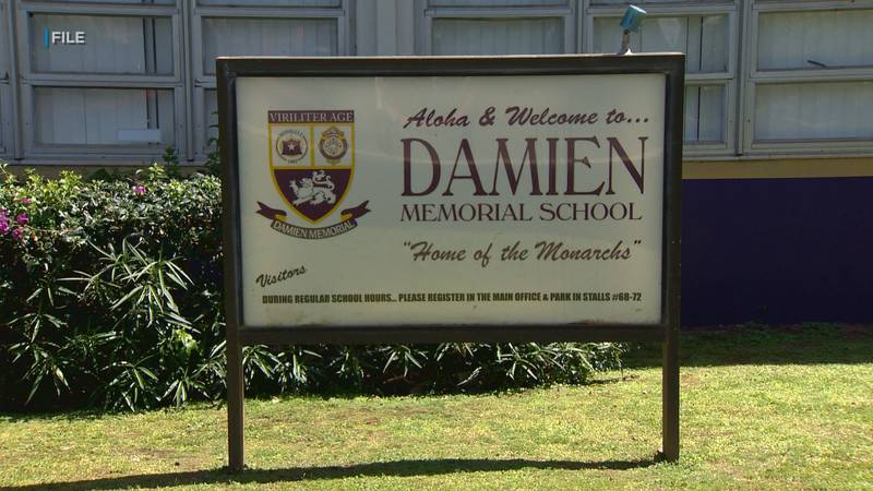 A sign on the campus of Damien Memorial School in Honolulu.