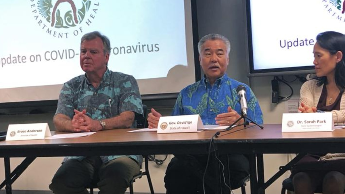 In this Feb. 14, 2020, file photo Hawaii Gov. David Ige, center, state Health Director Bruce...