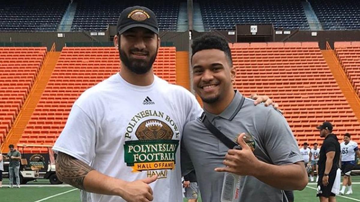 Iowa defensive end AJ Epenesa and Alabama quarterback Tua Tagovailoa served as honorary...