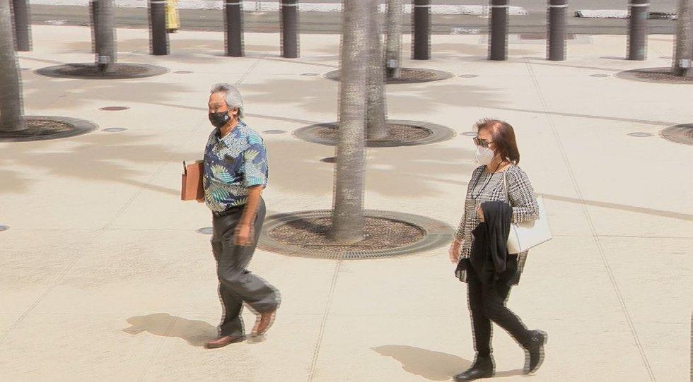 Mitsunaga & Associates employee Aaron and his wife, Joann Fujii arrive at federal court for...
