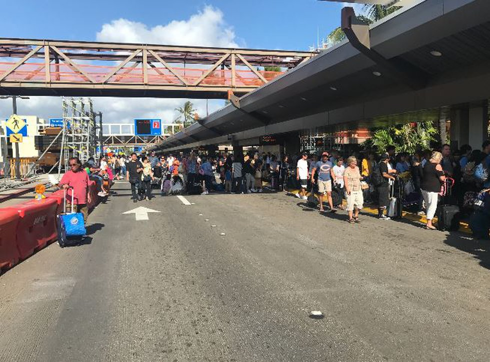 Crowds gathered outside Terminal 2 after it was evacuated following a security scare. (Image:...