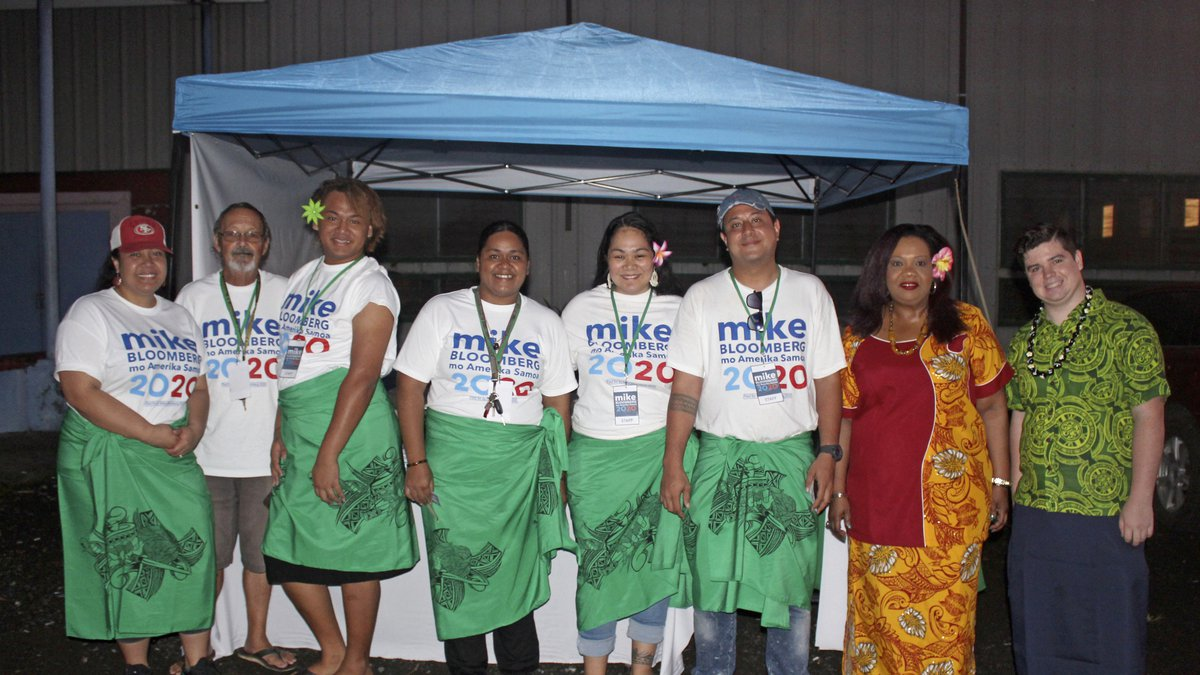 Supporters along with two US based officials for the Mike Bloomberg campaign gather on Tuesday,...